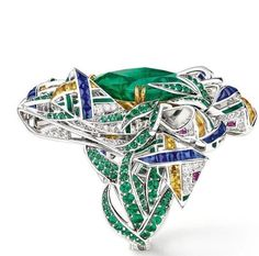 "CHAUMET est une fête collection - A reinterpretation of the Scottish tartan motif, the ""Pastorale Anglaise"" set takes inspiration from the Glyndebourne Festival with a fanciful twist.. •Pastorale Anglaise"" ring in white Gold, yellow Gold and Lacquer, set with a cushion-cut vivid green Emerald of 11.74 carats from Colombia Muzo, round Rubies and Emeralds, baguette-cut Saphhires and yellow sapphires, and brilliant-cut Diamonds."