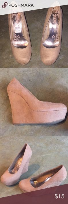 Wedge heels Camel colored wedge heels size 7. Very comfortable and cute. The color goes with pretty much anything. Worn about three times only. Good condition! Shoes Wedges