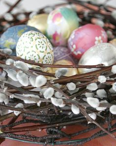 These colorful eggs fit snugly into the pussy willow nest, creating an enchanting Easter display.
