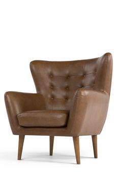 Charmante Kurven und leicht nach außen stehende Beine: Rydons Design ist inspiriert vom klassischen Ohrensessel der 60er Jahre. Raffiniert mit Retro-Touch.