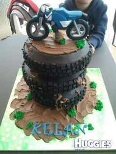 My son is dirt bike/motocross crazy so we thought this cake was rather fitting for the occasion :)
