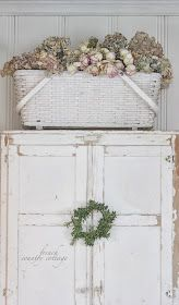 A vintage chippy glossy white baby basket is perfect on top of this shabby chic china cabinet!!! Bebe'!!! Love the dried roses and hydrangeas filling the basket!!! A perfect accent for this dining room from French Country Cottage blog  frenchcountrycottage.blogspot.com !!!