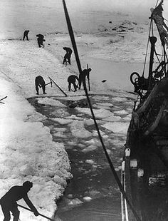 Crew members working to free the Endurance from the ice in Antarctica