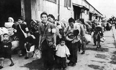 Displaced civilians are processed at Hakata Reception Center, Kyushu.