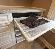 Laundry room flat drying racks made with pvc pipe, netting and drawer guides.