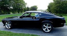 Check out this head turning Black on Black 1969 Mustang Fastback powered by a well dressed 302 Ford V8 engine linked to automatic transmission.