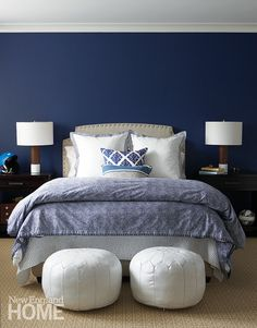 Navy blue bedroom - two poufs at the end of the bed - Click through for ideas for what to put at the end of the bed!