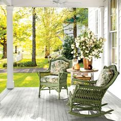 Charming Mountain Cottage: Front Porch with Green Rocking Chairs