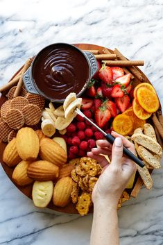 This chocolate fondue is a rich and creamy dark chocolate dip that takes just minutes to make. Serve your fondue with an assortment of fruit and sweet treats as dippers,…View Post Party Food Platters, Snack Platter, Dessert Platter, Platter Ideas, Antipasto Platter, Easy Chocolate Fondue Recipe, Chocolate Fondue Bar, Chocolate Fountain Bar, Charcuterie And Cheese Board