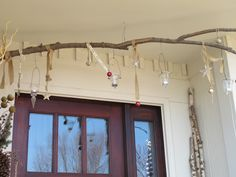 I used this branch from one of my trees to create an ongoing seasonal display.  This was my winter.  At night, tea lights add a glow to the front porch.