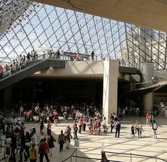 An underground wall with a view of the famous La Pyramide Inversée (the inverted pyramid) - Carrousel du Louvre #UtripParis