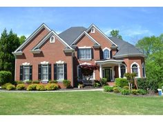 Brick front home on quiet cul-de-sac street, Large kitchen w/ new s/s appliances open to a large inviting family room that overlooks private backyard, Hardwoods on main, Bedroom