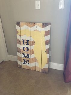 Take a palette apart, attach together - add a French cleat (to support weight when hanging), tape off chevron pattern, paint, sketch outline of your home state, paint, sketch desired font & paint.  Hang & enjoy!   CREATIONS BY Z