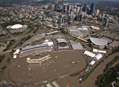 The Bow River overflows its banks into the grounds of Calgary Stampede and Saddledome hockey arena in Calgary Aerial Images, Alberta Canada, Natural Disasters, Calgary, Hockey, River, Banks, Sad, June