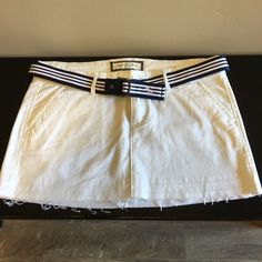 Abercrombie & Fitch Skirt w/belt Good condition.  Only worn 1 time while on vacation.  One small spot on front...shown in picture.  Can barely see.  I'm sure it will come out, but still pricing it accordingly! Abercrombie & Fitch Skirts Mini