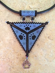Paw print triangle necklace by BeadSplashHCJ on Etsy, $35.00