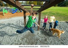 A Young Child Having Fun Playing On Equipment At A Playground. Stock Photo 88339270 : Shutterstock