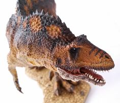 The Rebor Acrocanthosaurus dinosaur model.