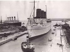 """ocean-liners: """" The Empress of Britain, with Olympic laid up in the background """""""