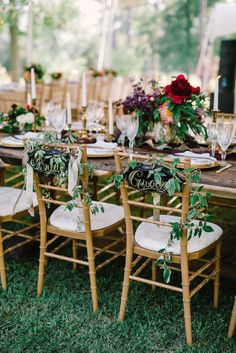 Gold Chiavari Chairs with Wild Greenery and Signs | Amy Osaba Event Florals and Event Design | Belle of the Ball Events | Diastole Farms | Harwell Photography https://www.theknot.com/marketplace/harwell-photography-atlanta-ga-211226