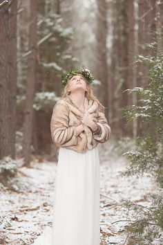 Brides don't traditionally want to hide the beauty of their dress under outerwear, however there is something to be said about what a fur coat can add. It won't just keep you toasty during the wedding photo shoot, it will add more to the story and theme of your big day. | Faux Fur Inspiration for Brides and Bridesmaids