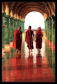 barefoot Buddhist monks walking down beautiful hall: garden of the far east