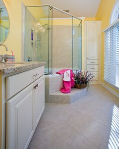 A unfunctional closet was removed from this house and the space was added to another area in the house to create a daughter's bathroom in this whole house remodel.  Photos by Ray Strawbridge Commercial Photography