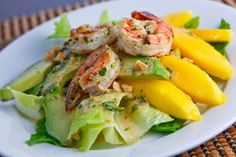 Mango, Avocado and Grilled Shrimp Salad with a Peanut Dressing Ingredients: 2 tablespoons unsweetened coconut milk 1 lime (juice and zest) 1 tablespoon fish sauce 1 tablespoon peanut butter 1 birds eye chili (sliced) 1 teaspoon palm sugar (grated or brown sugar) 1 tablespoon cilantro (chopped) 1 tablespoon mint (chopped) 1 mango (stoned, scooped and sliced) 1 avocado (stoned, scooped and sliced) 2 handfuls salad greens 2 green onions (sliced) 2 tablespoons peanuts 6 tom yum grilled shrimp