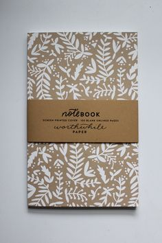Relax in a forest of your own thoughts. Hand drawn forest ferns and nature shapes, screen printed on quality recycled cover stock, make this notebook a true gem! Filled with 100 unlined pages for dood