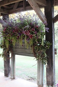 A garland of grapevine, Southern Red Oak, magnolia and Mexican Sage in a beautiful old mantle...what a wonderful way to show off all those flowers.