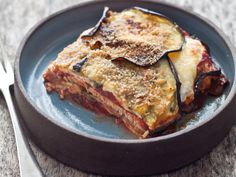 Chicken and Eggplant Parmesan | In this delicious new take on classic eggplant Parmesan, broiled eggplant is layered with fresh mozzarella, basil and slices of chicken. If basil isn'...