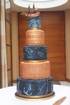 Nautical Wedding Cake in Navy Blue with chalkboard etched effect and metallic copper