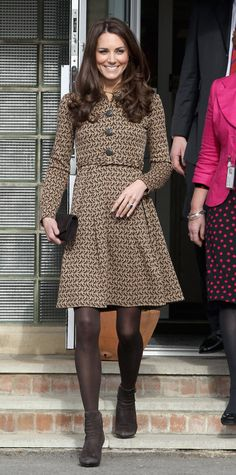 I love this outfit... Perfect for fall/winter... Orla Kiely dress and Aquatalia Royal ankle boots.