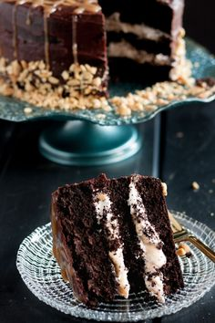 Snickers cake - rich chocolate cake layered with homemade nougat, caramel, and peanuts, topped with rich ganache