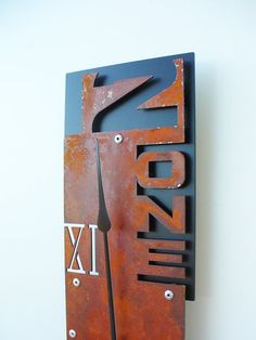 Outnumbered Clock VII Rusted Modern Wall Clock by All15Designs