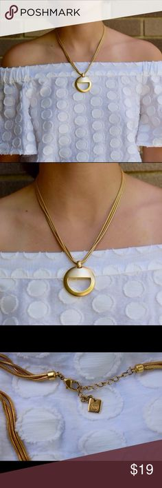 Gold circle pendant necklace Amazing condition! No scratches. The chain is about 16.5 inches. The pendant has a diameter of 1.5 inches. The necklace is a beautiful gold that really stands out with white shirts or any easy, breezy summer outfit. Feel free to comment with any questions or offers! Jewelry Necklaces