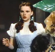 Based on the 1900 children's novel, The Wonderful Wizard of Oz by L. Frank Baum, the film stars Judy Garland, Ray Bolger, Jack Haley, Bert Lahr, and Frank Morgan, with Billie Burke, Margaret Hamilton, Charley Grapewin, Clara Blandick and the Singer Midgets as the Munchkins.  Notable for its use of special effects, Technicolor, fantasy storytelling and unusual characters, It has become, over the years, one of the best known of all films.