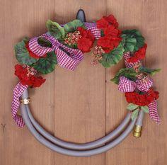 Wreath, Garden Hose, Silk Flower, Ribbon, Berries, Geranium. $45.95, via Etsy.