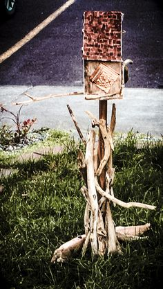 Copper bird feeder with driftwood accents