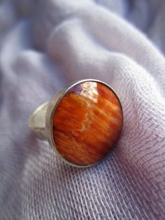 Deep orange spondylus shell  and silver ring by Perunz on Etsy, $40.00