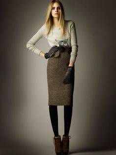 Cara Delevingne for Burberry Pre-Fall 2012 Collection. Love the style. Not into the colour.