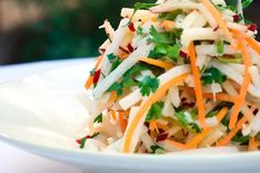 Grilled Chicken w/ Jicama Slaw  1 cup sliced jicama 1/4 cup sliced carrot 1 medium green onion ¼ cup chopped cilantro or parsley 2 tsp olive oil 1 1/2 tbsp 100% maple syrup 2 tbsp fresh lime juice 1 tsp sesame seeds 120 gm raw chicken breast Salt and pepper to taste  Slice jicama and carrot julienne or shave with a vegetable peeler. Add green onion and parsley. Mix lime juice, maple syrup and 1 tbsp of olive oil for dressing. Cook chicken with remaining olive oil.
