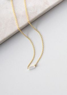 Simple, classic and modern. The Baguette Diamond necklace hits all the right notes | Vrai & Oro