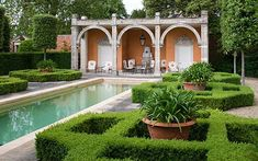 The loggia and swimming-pool in 'Italy', flanked by box and agapanthus - Picture: ANDREW LAWSON