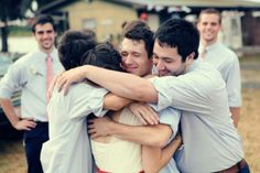 Groomsmen hugging the bride. I need this picture at my wedding.