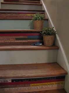 I hate carpeted stairs, and love all the ways people are finding to treat them as art now! This is one of the coolest I have seen. Old store yardsticks attached to the fronts of each step. So unique!
