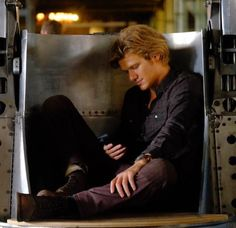 He sighed and slumped back .pulling his phone out of his pocket .
