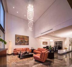Sala naranja: Salas de estilo moderno por URBN