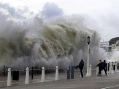 Huge waves burst over the promenade at Dover The worst storms in a decade have battered southern Britain, killing three people and flooding roads and towns Weather Rock, Weather Snow, Weather Watch, Wild Weather, Bad Storms, Severe Storms, Severe Weather, Extreme Weather, Water Waves
