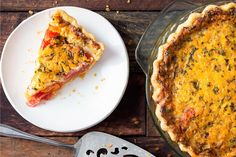 Ripe heirloom tomatoes and sharp cheddar cheese are a match made in heaven in this savory pie.